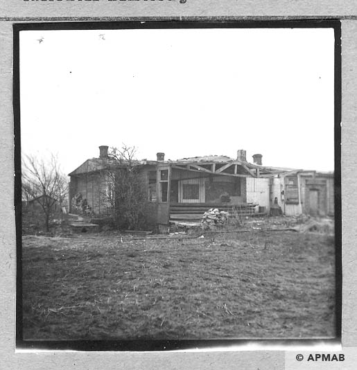 A fragment of a wooden post camp barrack.1959 APMAB 4345