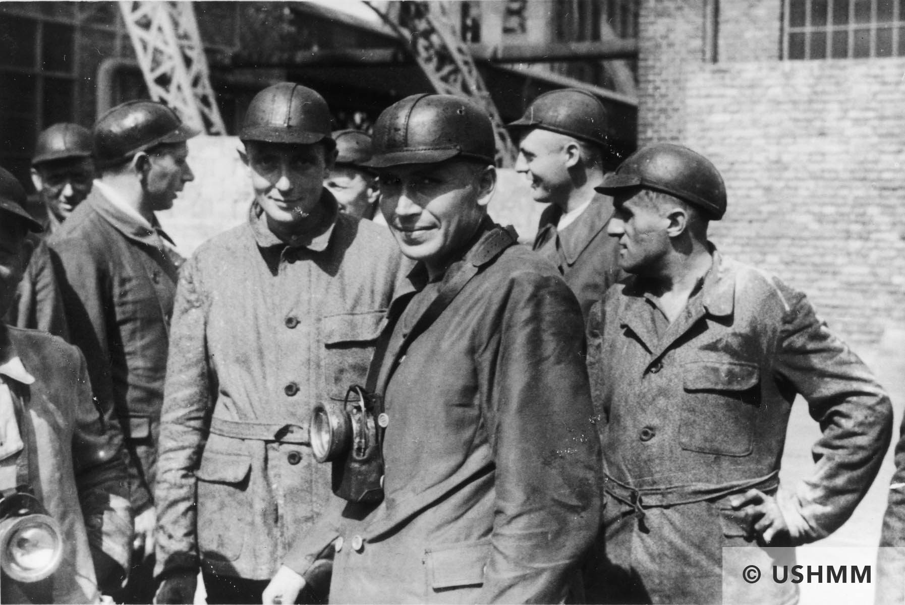 A large group of SS officers visit a coal mine near Auschwitz. 1944 USHMM 34829