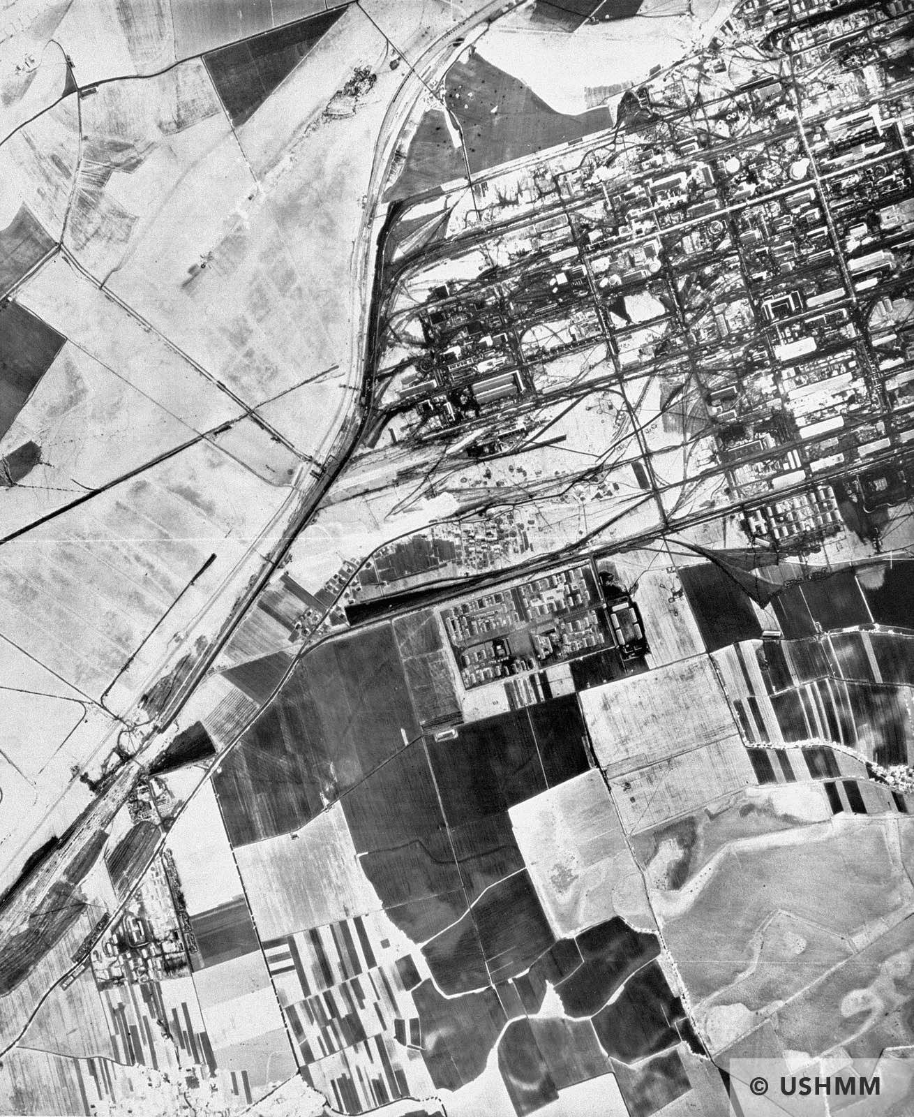 A partial aerial reconnaissance view showing the Buna plant and Auschwitz III prisoner area. 1944 or 1945 USHMM 04302