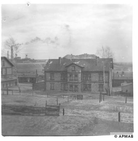 Administrative building and barracks in the background. 1959 APMAB 4378