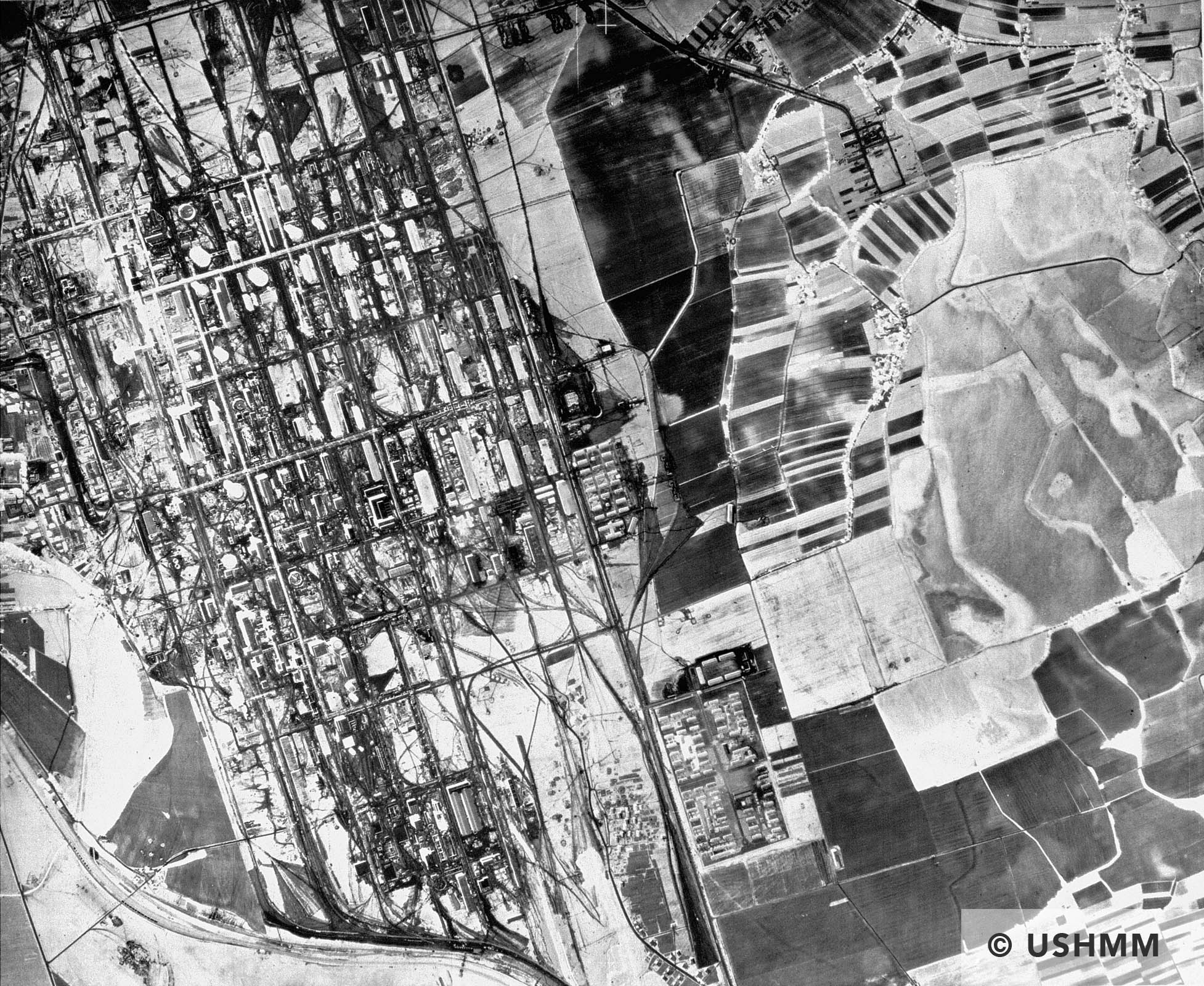 Aerial photograph of the Auschwitz area showing a partial view of the I.G. Farben plant and the associated Monowitz concentration camp. 31 May 1944 USHMM 04350