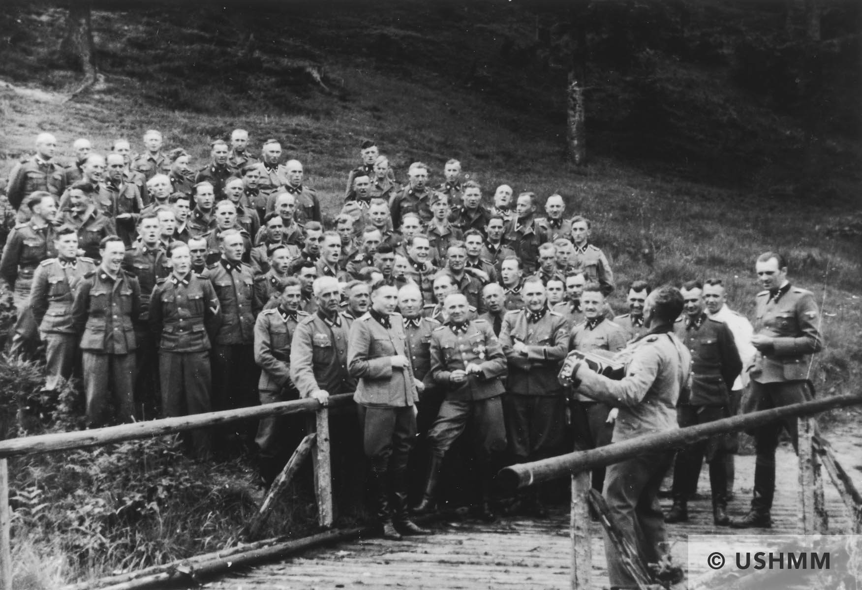 An accordionist leads a sing-along for SS officers at their retreat at Solahütte outside Auschwitz. USHMM 34739