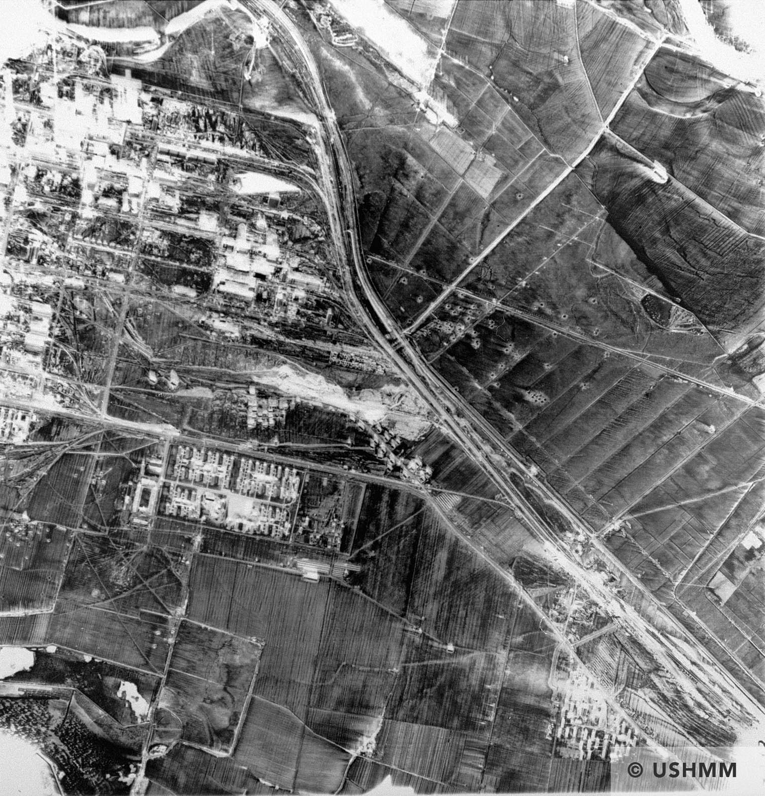 An aerial reconnaissance photograph IG Farben plant top, Auschwitz III camp left. 1944 or 1945 USHMM 04004