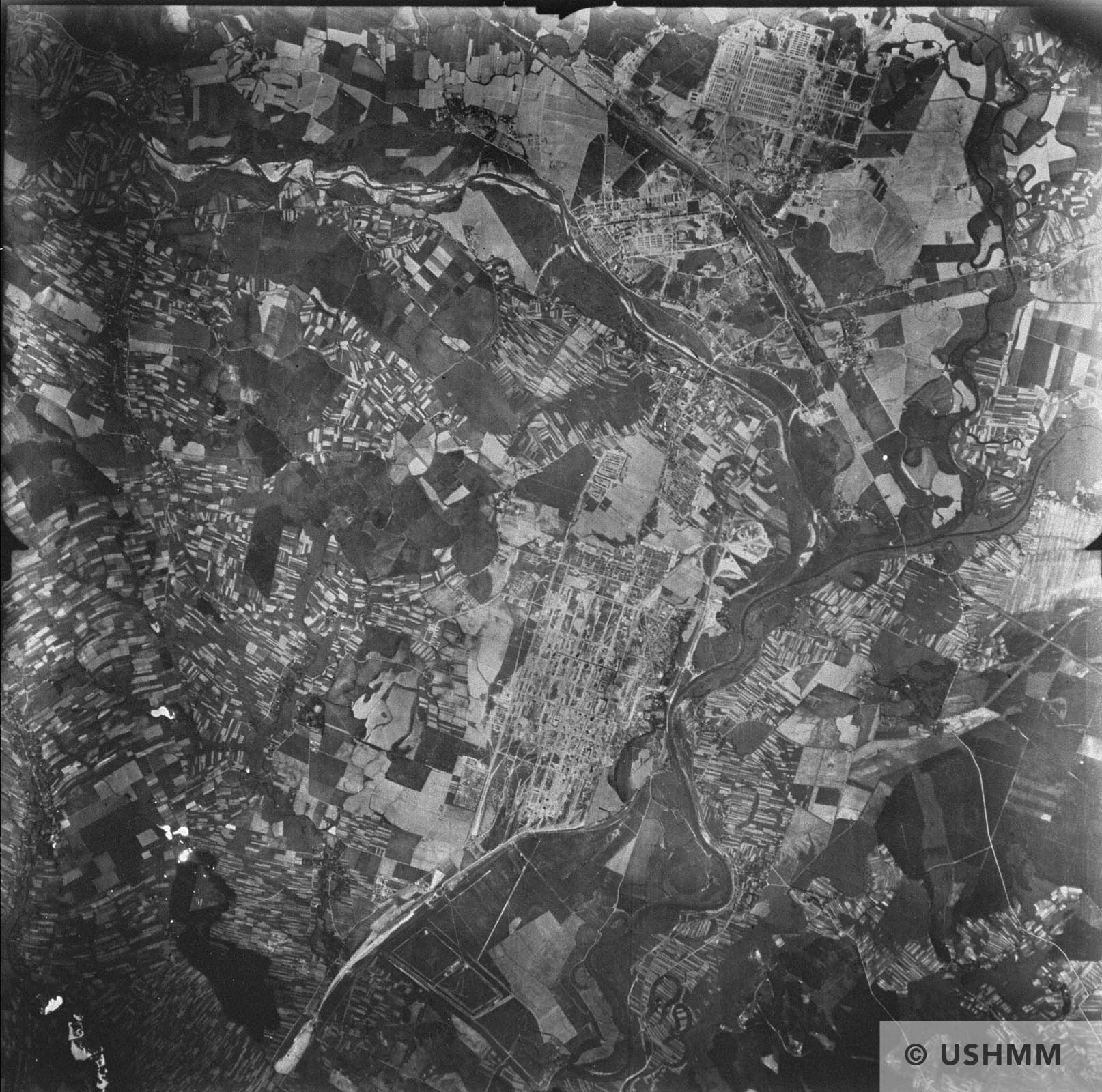 An aerial reconnaissance photograph of the Auschwitz area showing Auschwitz I, Auschwitz II, and Auschwitz III, as well as the I.G. Farben complex. 31 May 1944 USHMM 04144