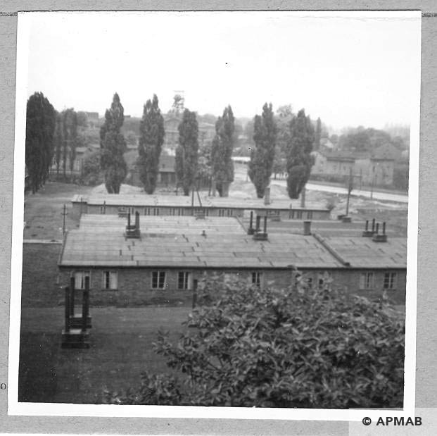 Annarampe foreground barracks, background Leon III shaft where prisoners worked. 1966. APMAB .9778