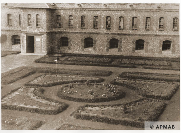 Beautifully manicured lawns and flower beds between the front of the main workshop building and the guard house entrance gate 1944 APMAB 95285