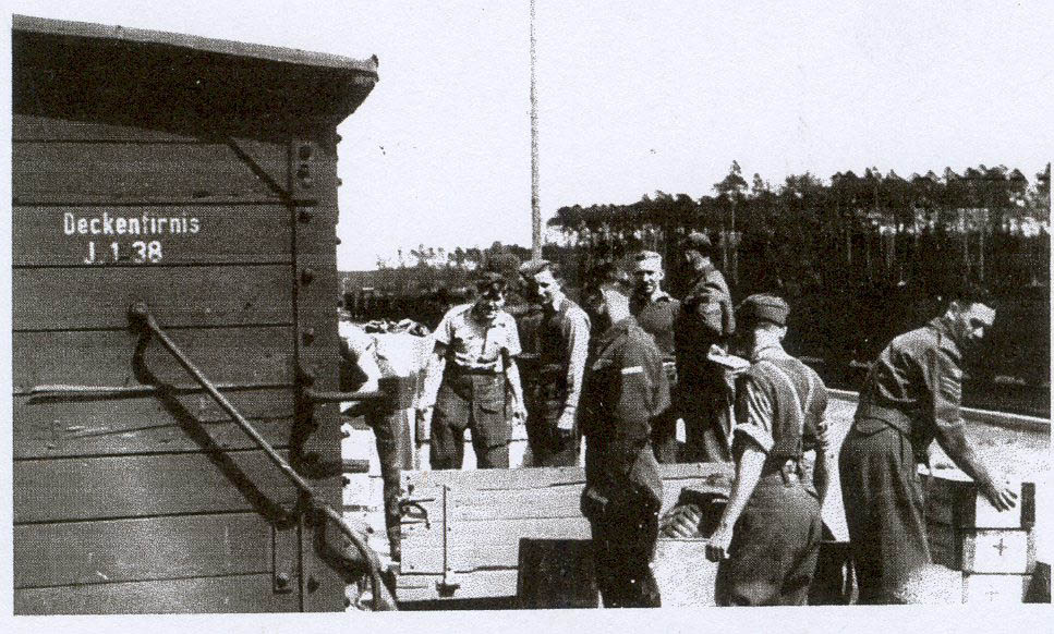 British Prisoners of War unloading red cross parcels. Ociepski