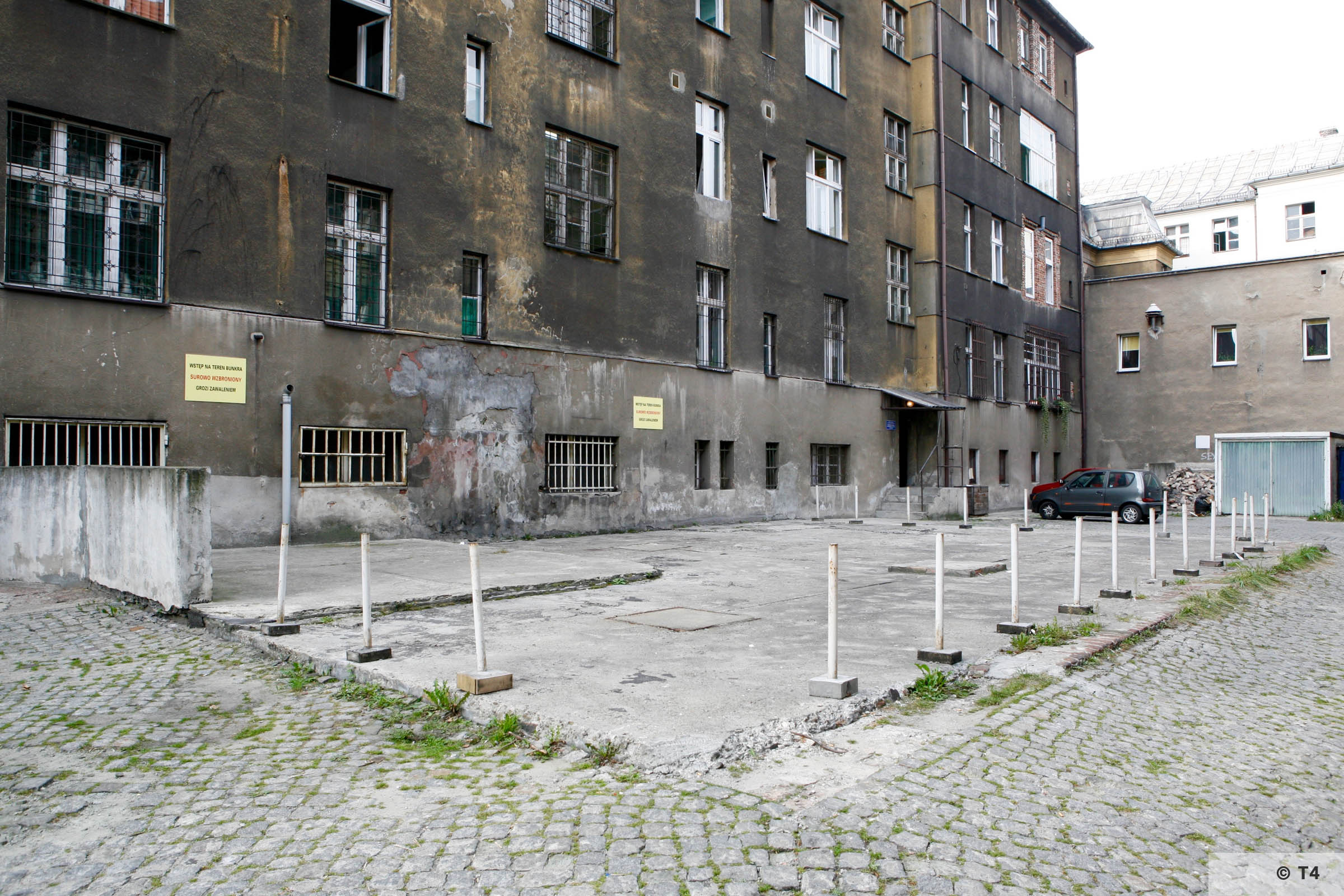 Building of the former Gestapo Headquarters in Katowice. Air raid bunker is undeneath the fenced off area. 2006 T4 3737