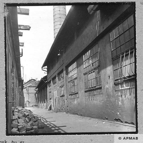 Building where prisoners lived visible from the steel works. 1963 APMAB 4639