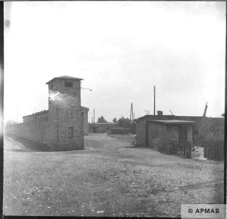 Corner guard tower next to main gate and fragment of fence. 1963 APMAB 5670
