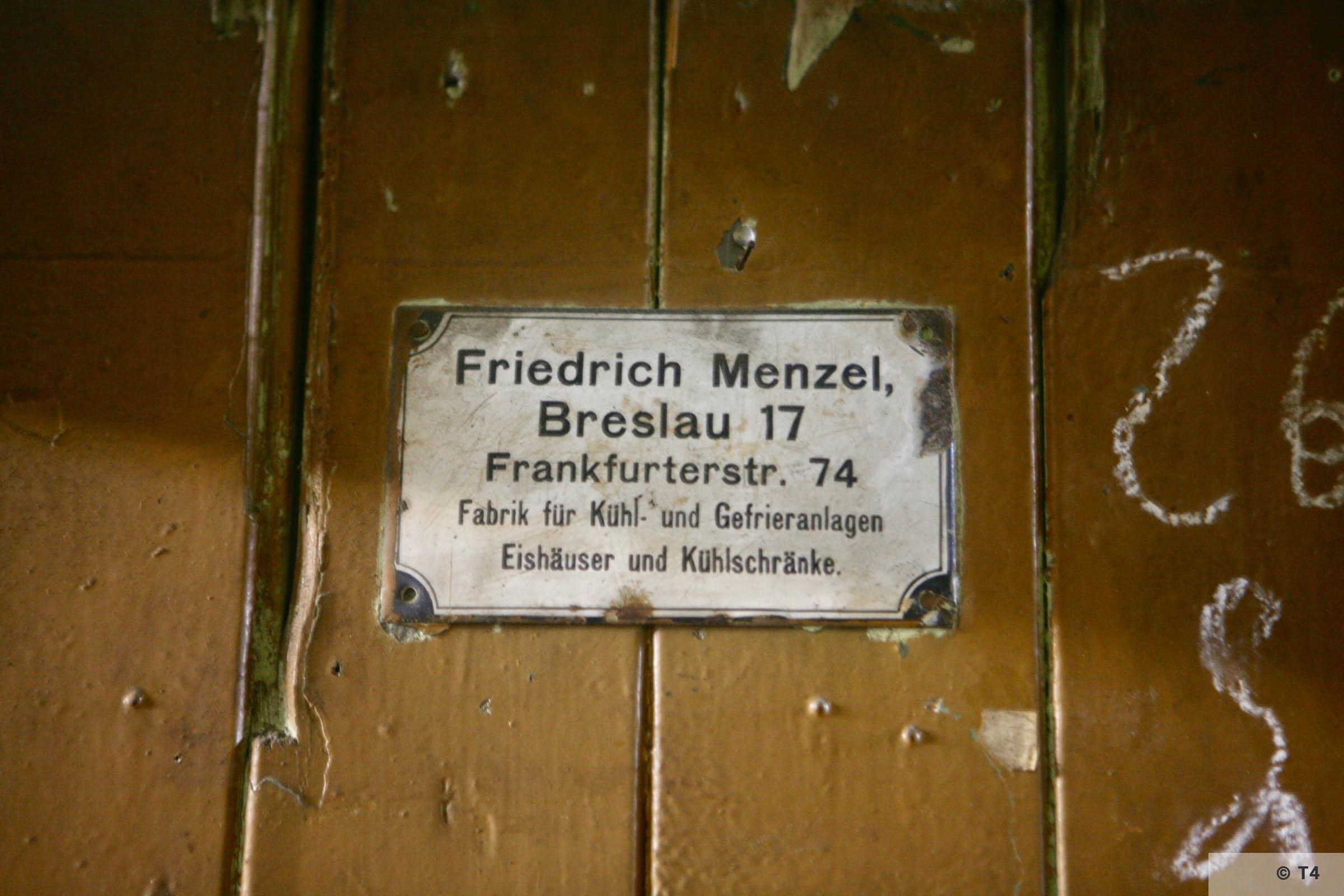 Door sign inside the former kitchen block of sub camp Hindenburg. 2007 T4 3657