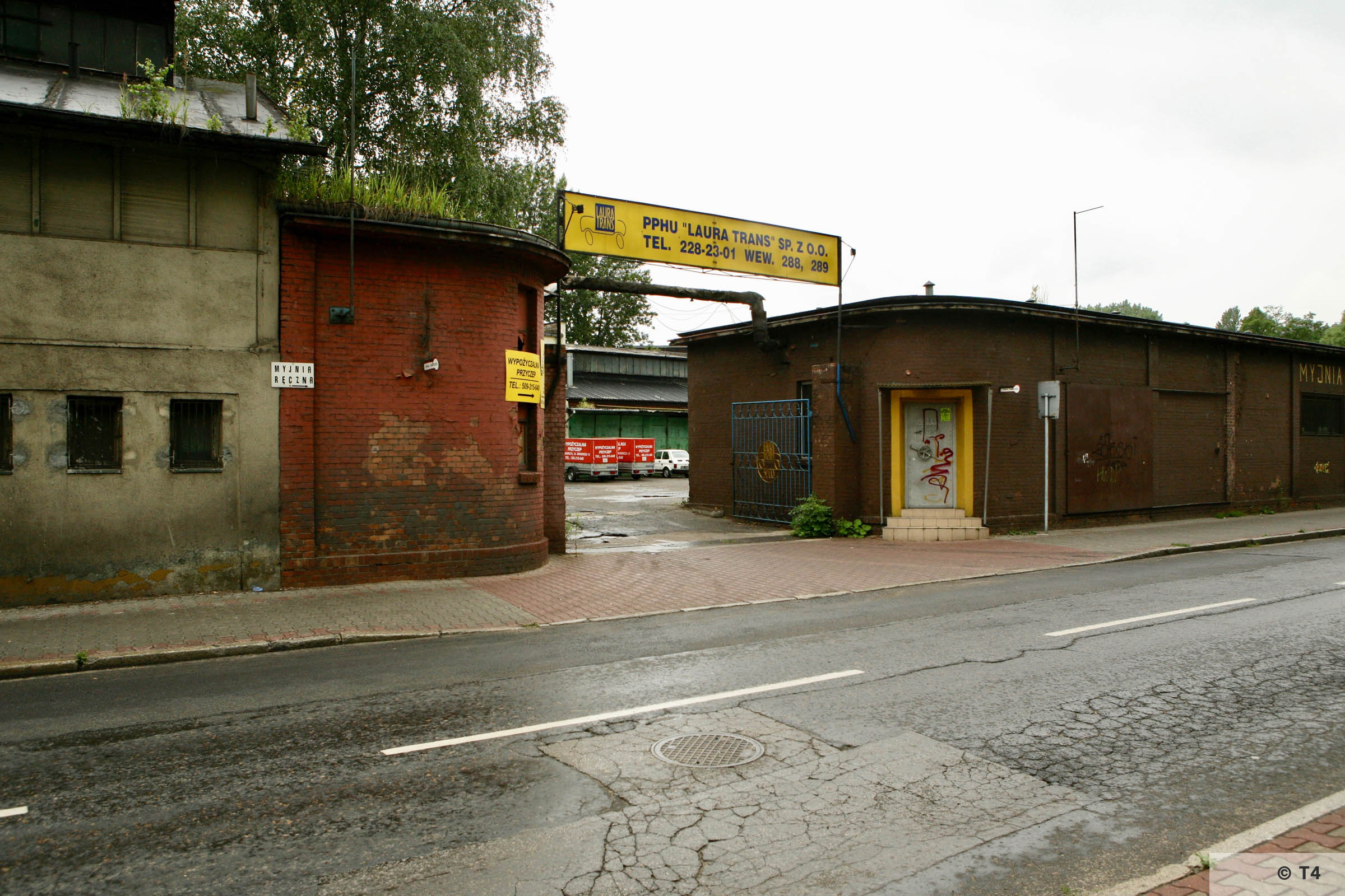 Entrance gate to the former Arbeitslager Laurahütte sub camp. Workshop on the left where prisoners slept. 2007 T4 9526
