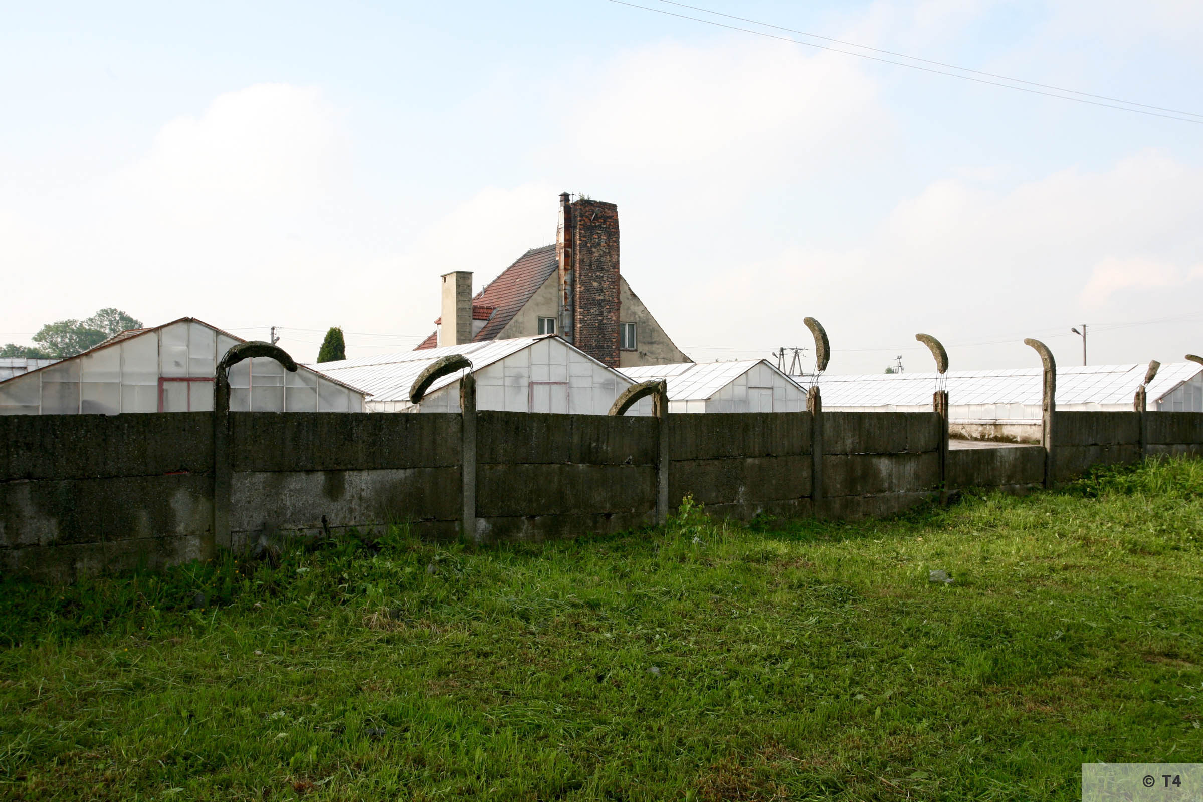 Former horticultural laboratory, new greenhouses and fence. posts. 2006 T4 5155