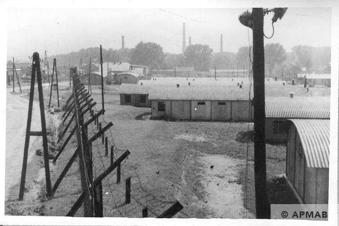 General view of the camp form Guard tower No 2 on North East corner in the background refinery visible. APMAB 6672