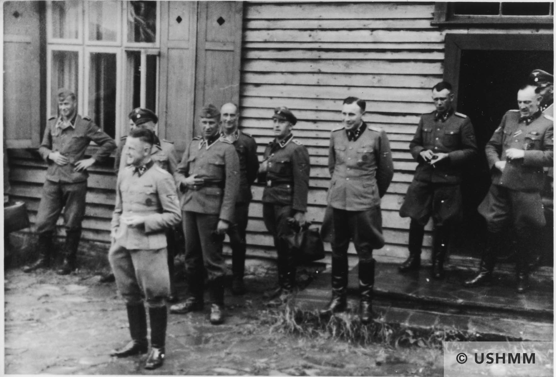 Group portrait of Nazi officers standing in front of a building in Solahütte. USHMM 34578