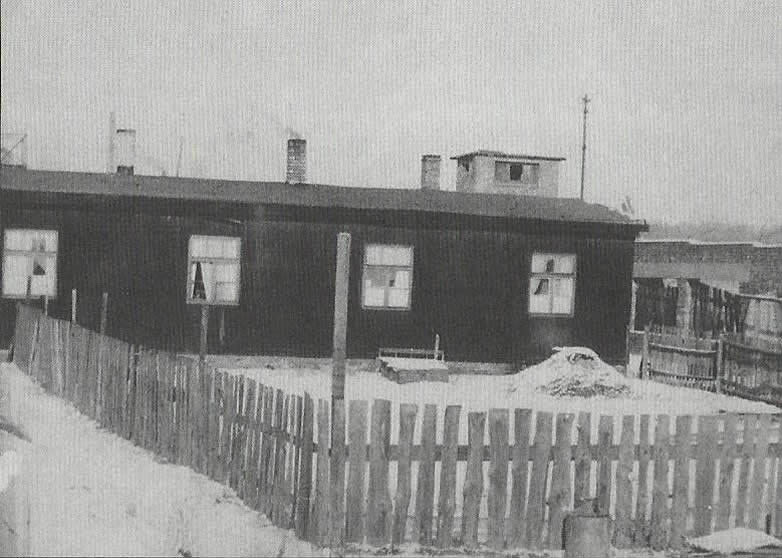Long wooden barrack housing the camp office. The Oberkapo Hermann Joseph´s office the dental station theatre and prison room. This building was situated by the front entrance. Shortly after the war