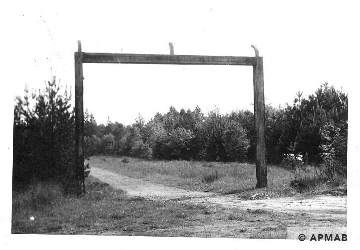 Main gate and guard tower on background. 1965 APMAB 8764