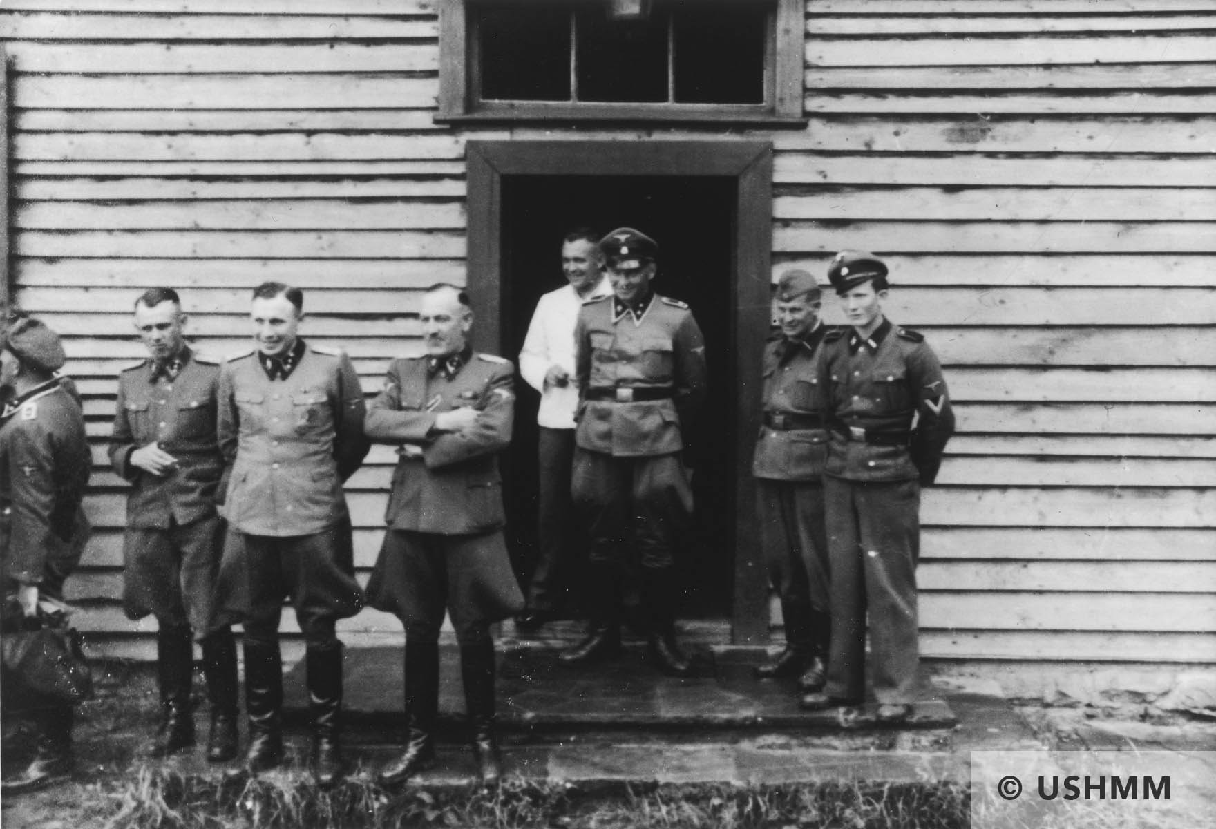 Nazi officers stand on a terrace of Solahütte. USHMM 34740