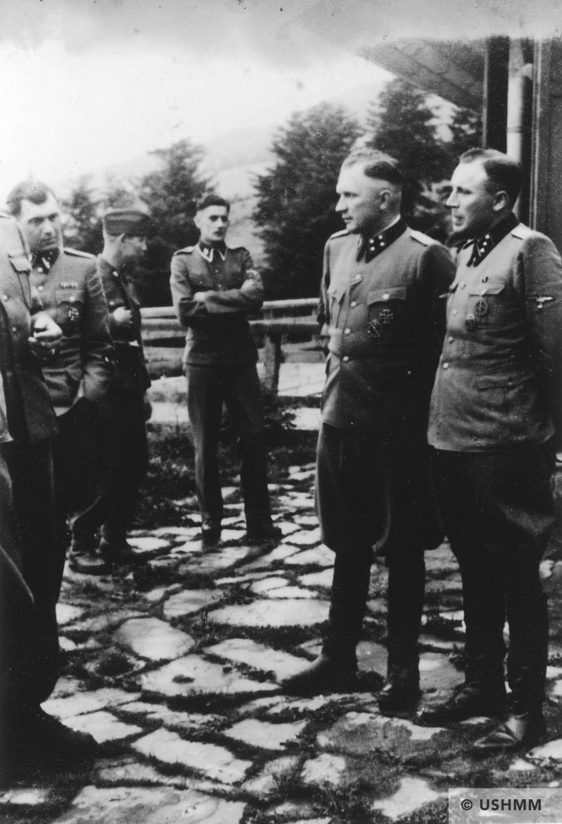 Nazi officers stand on a terrace of Solahütte. USHMM 34741