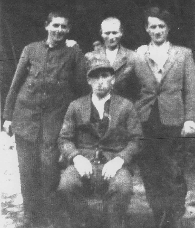 Photo taken shortly after liberation in 1945 - Henry Bawnik (Herzko) left, Kapo Hersh Goldberg (seated)