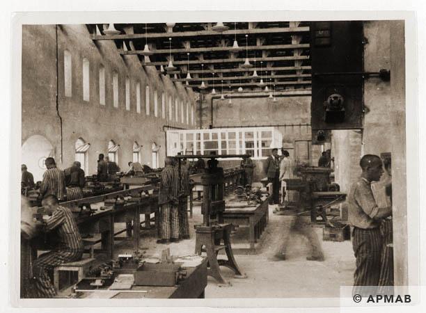 Prisoners at work in the main workshop. 1944 APMAB 31796