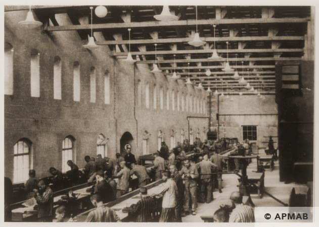 Prisoners at work in the main workshop. 1944 APMAB 84416