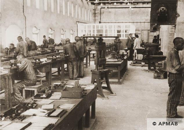 Prisoners at work in the main workshop. 1944 APMAB 95270
