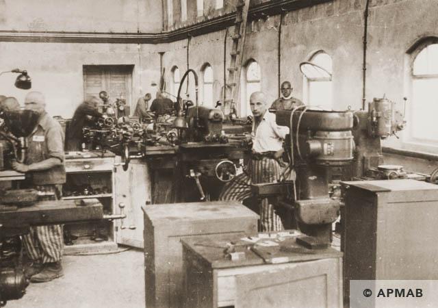 Prisoners at work in the main workshop. 1944 APMAB 95272