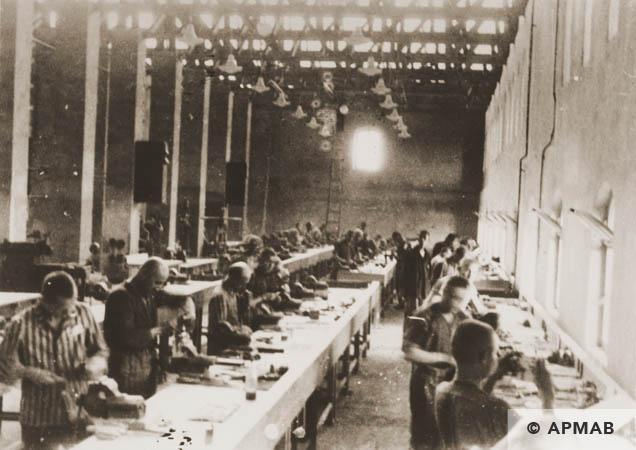 Prisoners at work in the main workshop. 1944 APMAB 95273