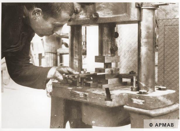 Prisoners at work in the main workshop. 1944 APMAB 95279