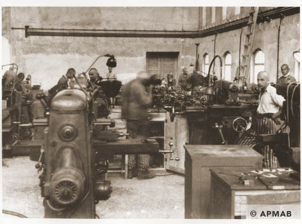 Prisoners at work in the main workshop. 1944 APMAB 95280