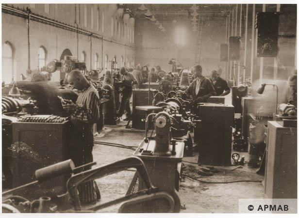 Prisoners at work in the main workshop. 1944 APMAB 95282