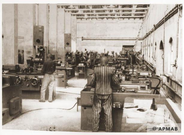Prisoners at work in the main workshop. 1944 APMAB 95286