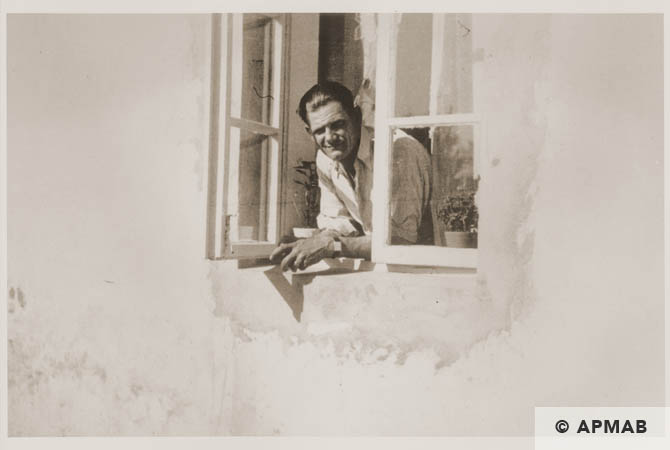 Probably shows a Siemens civilian worker leaning out of a window. 1944 APMAB 95287