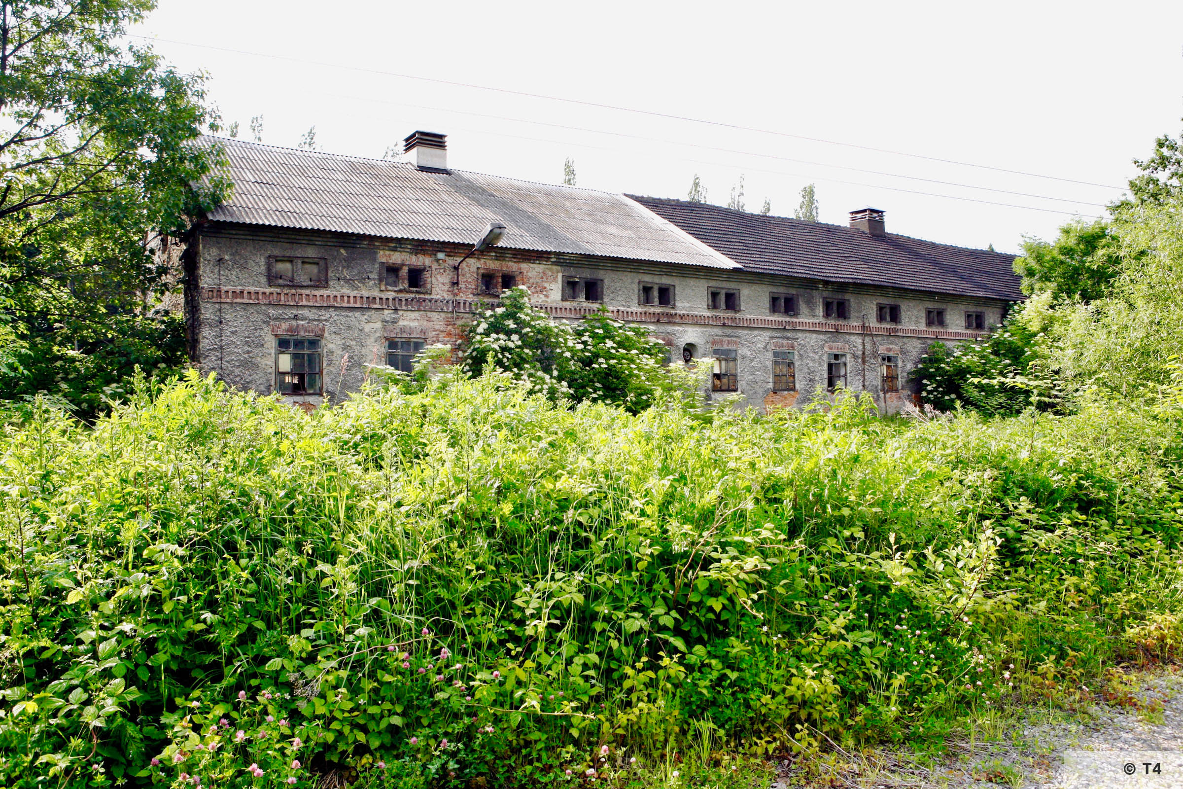 Stone stable block where the prisoners lived from outside the former sub camp. 2006 T4 6717
