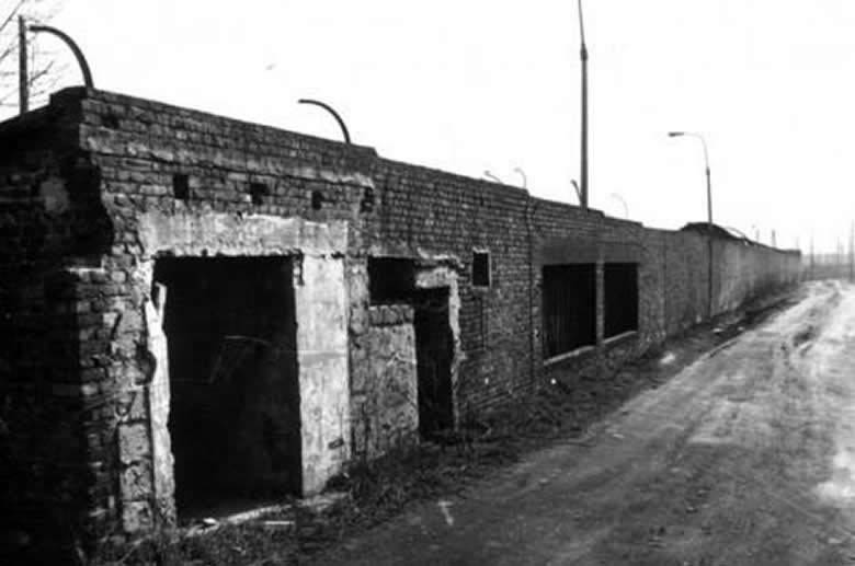 The front wall at Lager Sud. The entrance gate was to the left. Post War.