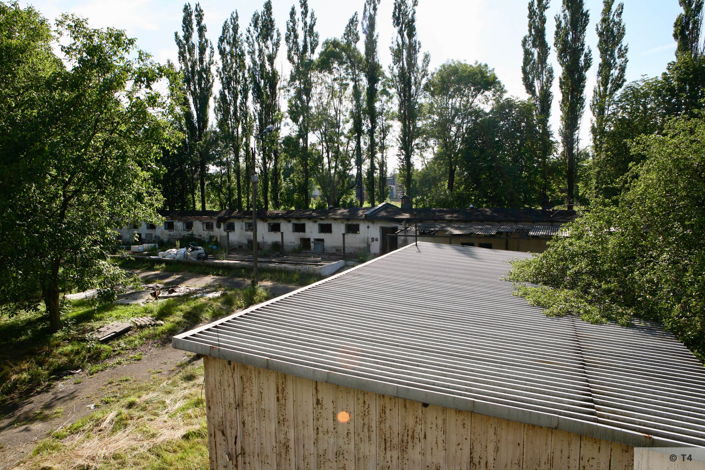 View from stable block where prisoners lived to stable block where Kapos lived and hospital. 2007 T4 9338