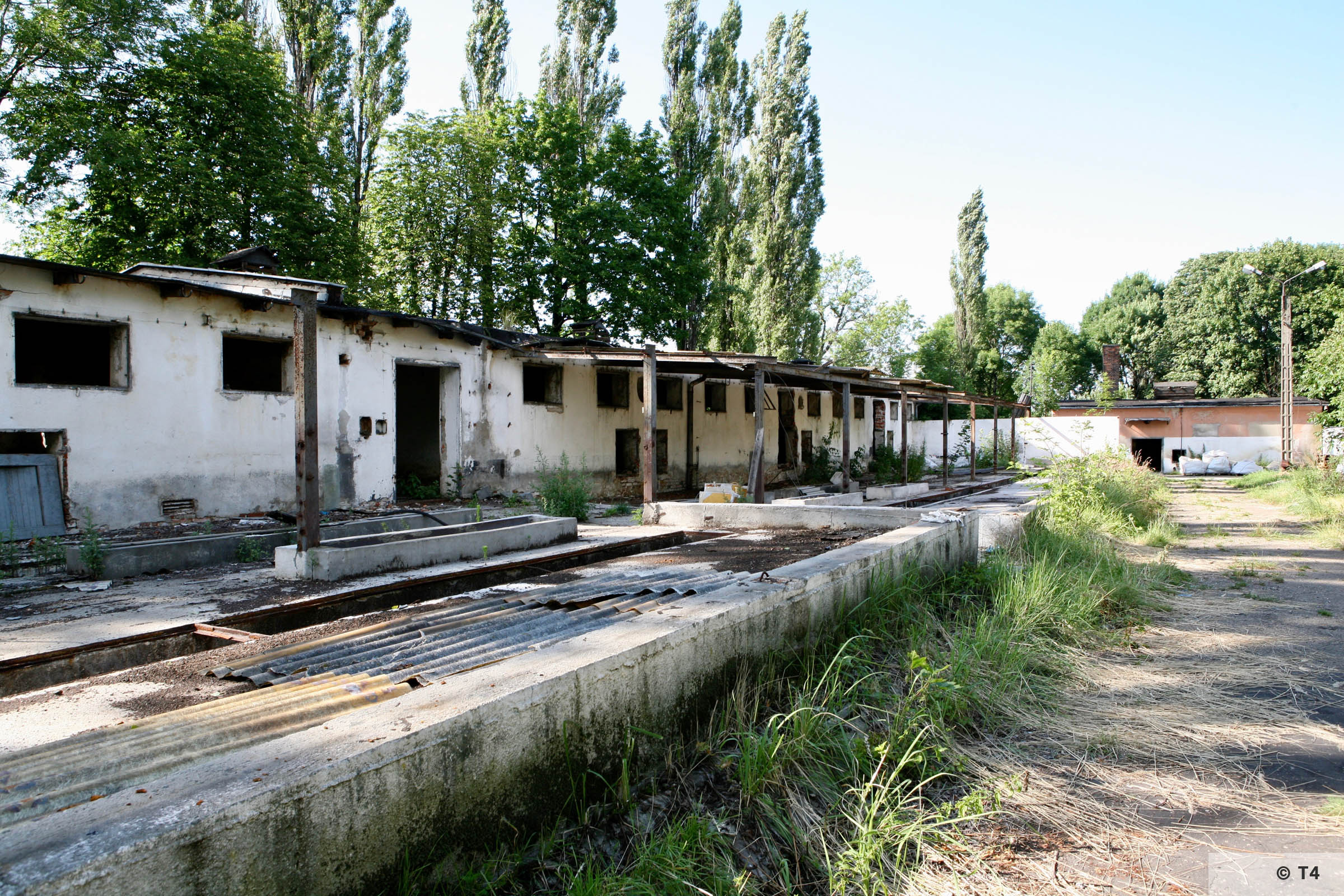 View of the single storey stable block on the left from inside the former sub camp where the kapos, hospital were organsised. 2007 T4 9294