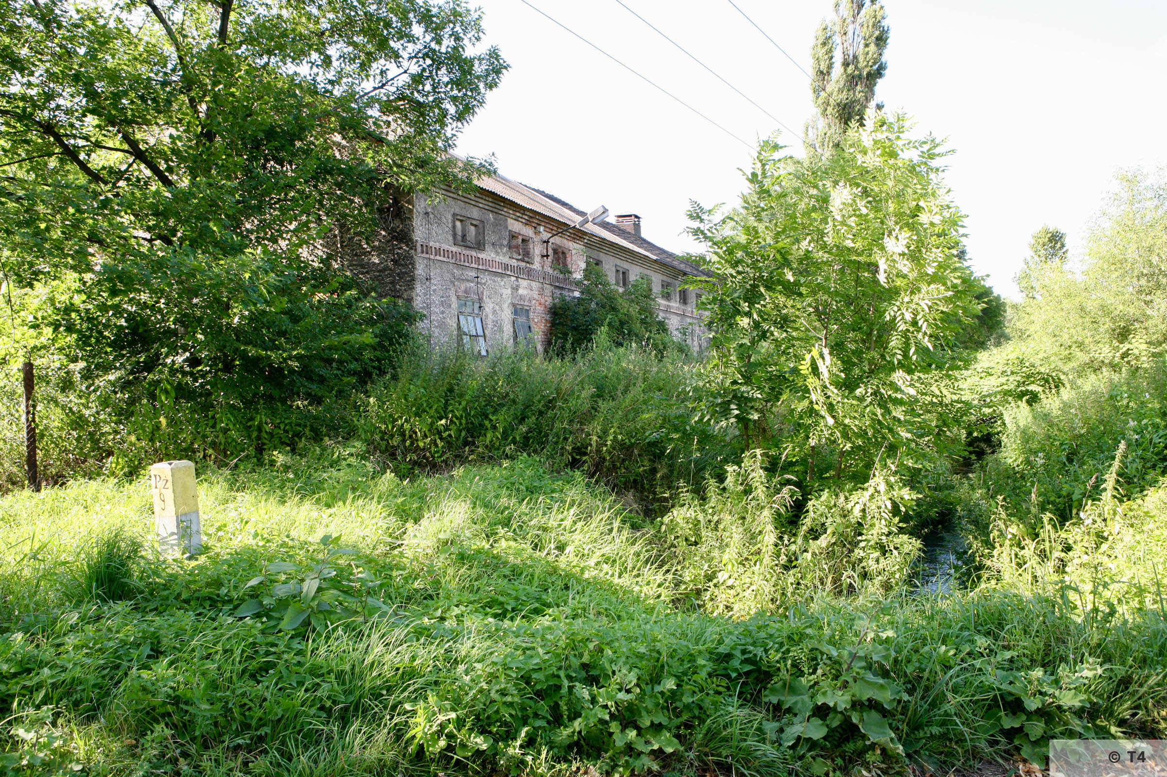 View of the single storey stable block where prisoners lived from outside the former sub camp. 2007 T4 9393